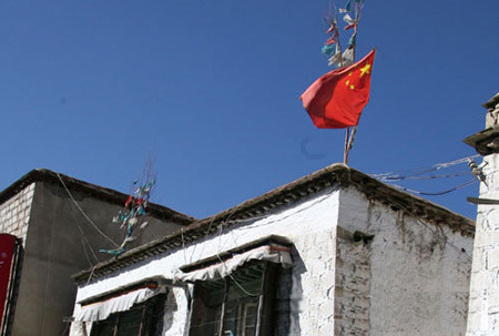 Tibetans Forced To Fly The Flag Of Their Oppressor!