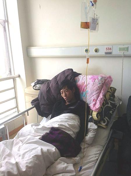 Mr Tsering Gyaltsen Beaten 9/29/13 For Refusing To Fly China's Flag