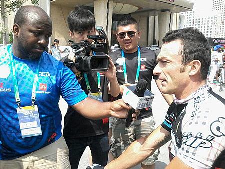Mattia Gavazzi and his cycling team winners of a propaganda cycling event in Amdo Region of occupied Tibet