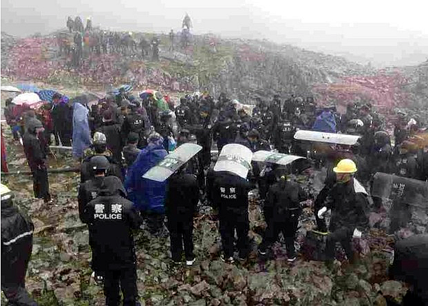 China's paramilitary beat and arrested Tibetan women who opposed mining of a local mountain.
